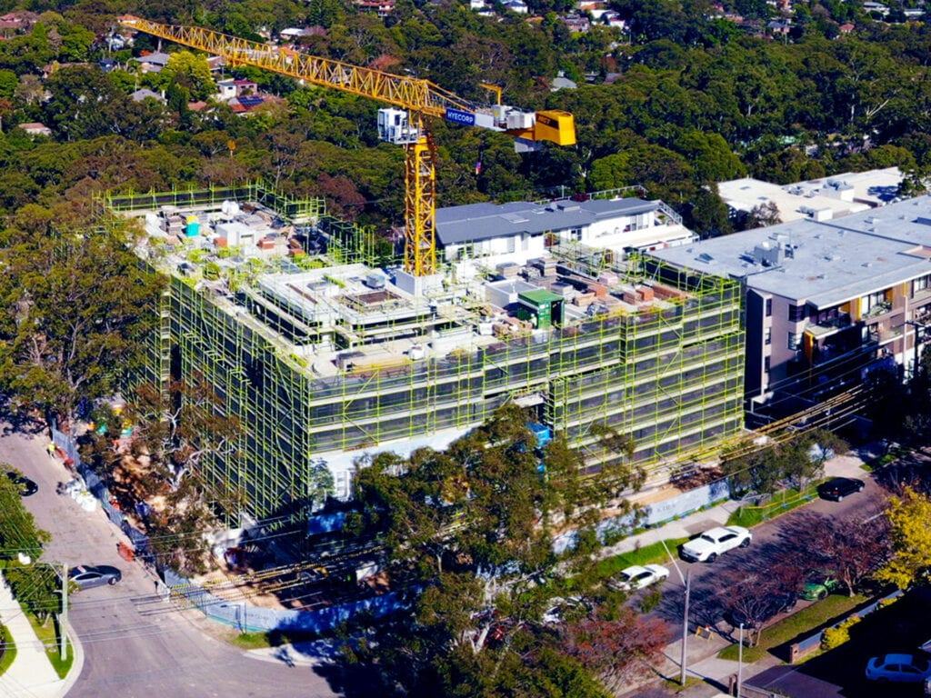 residential building under construction surrounded by trees